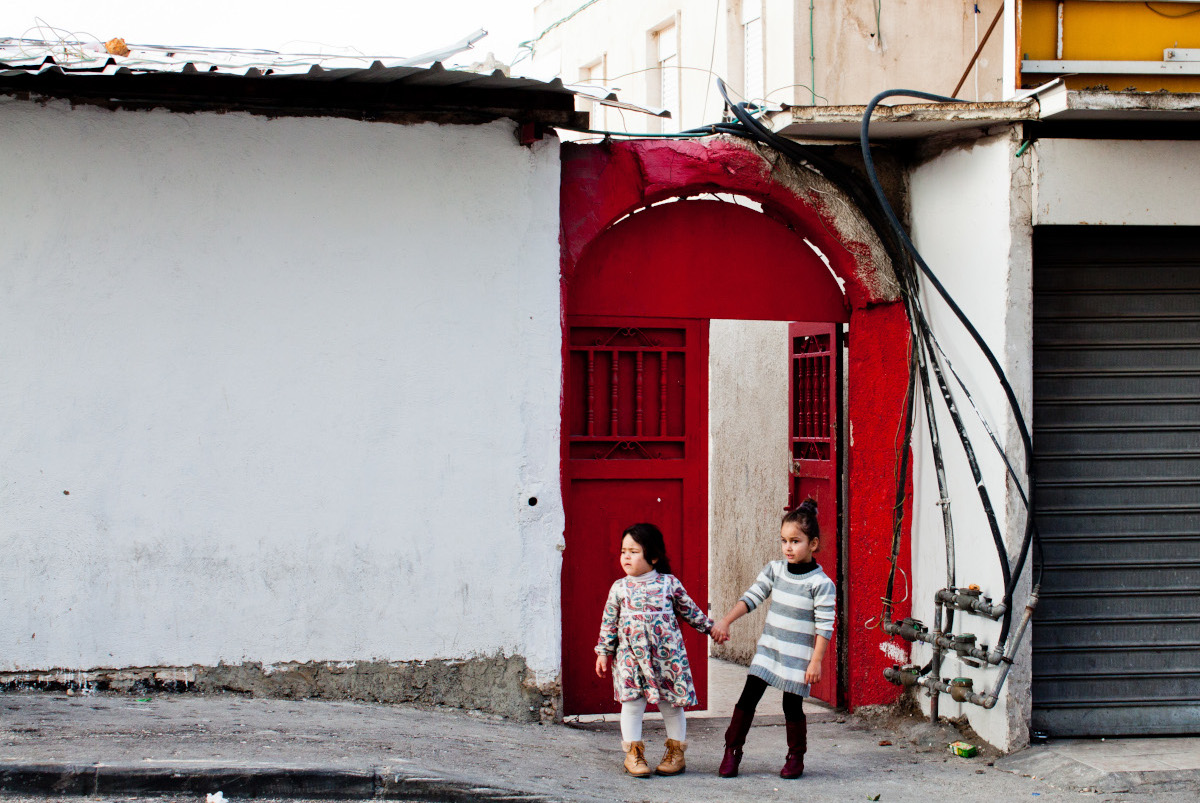 Girls in Jerusalem with red doors