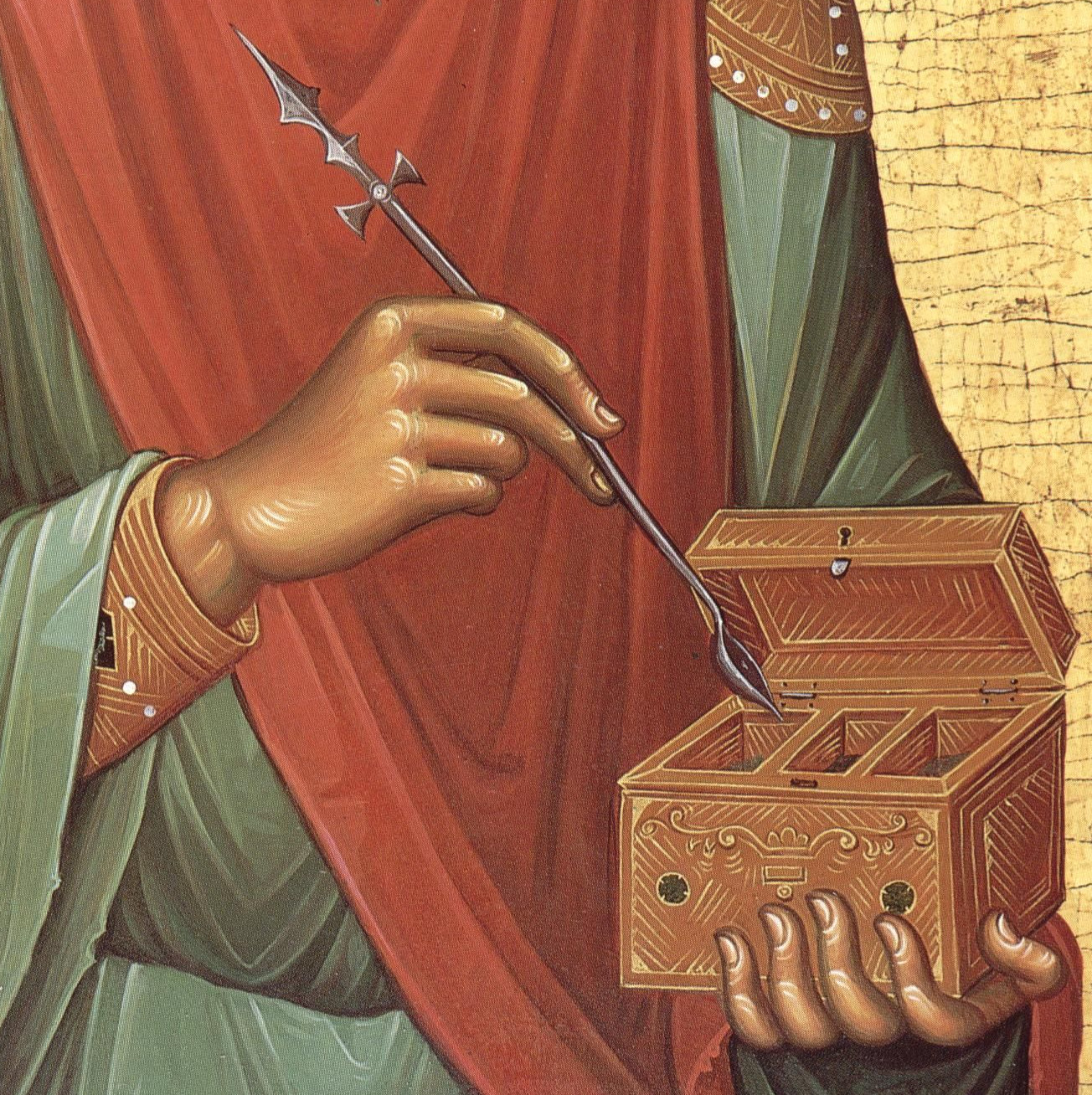 Hands of St. Panteleimon holding a cross and medicine box