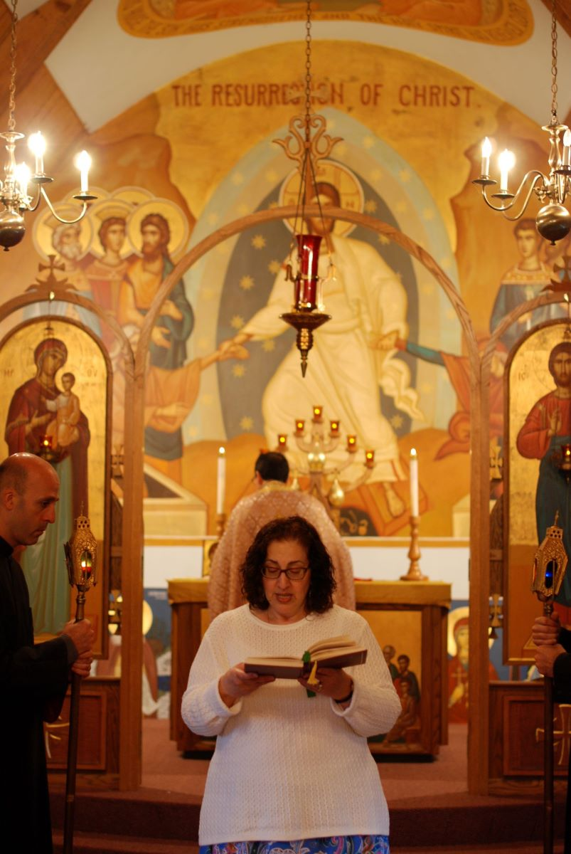 Woman reading the epistle in church
